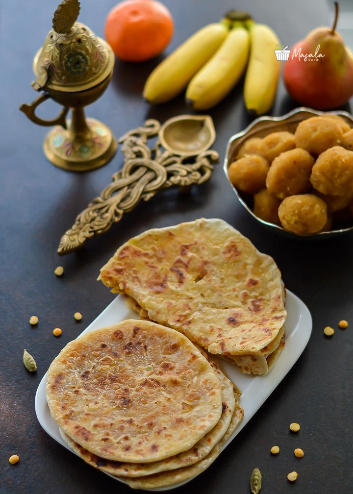 Bobbatlu or puran poli served with fruits as prasadam.