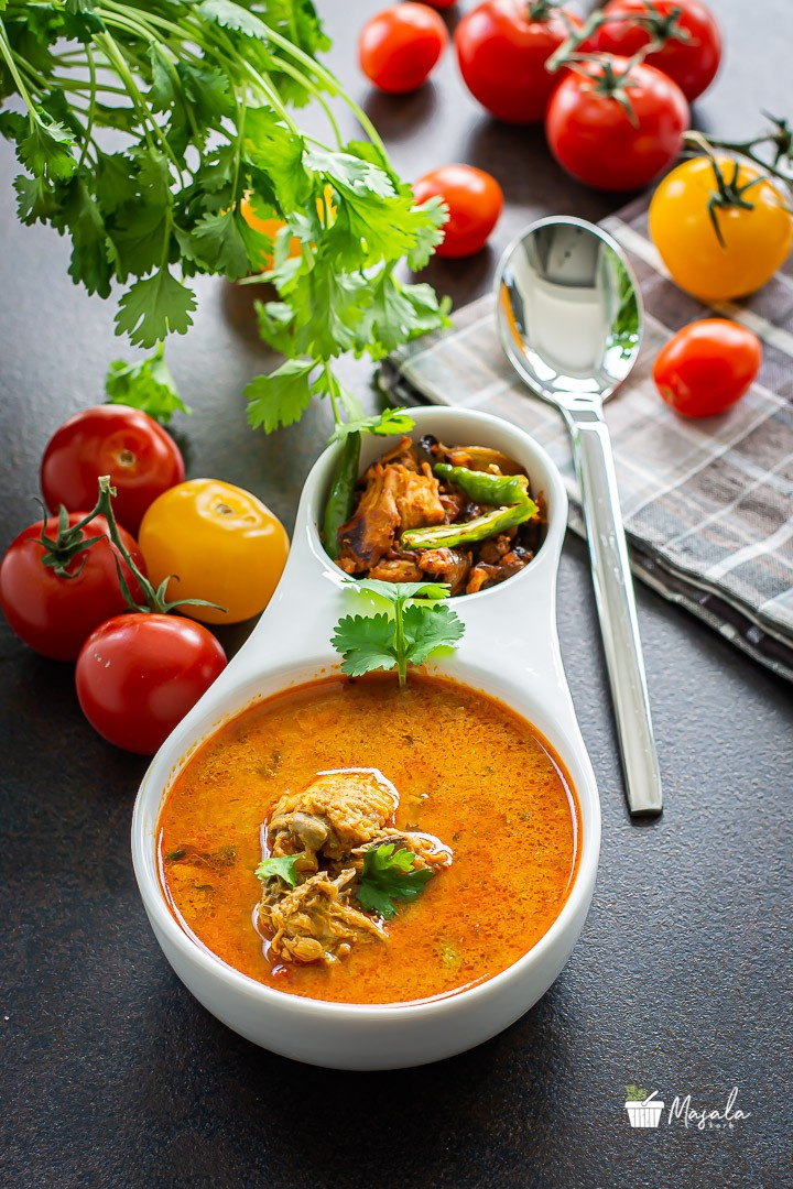 Chicken Rasam, Indian Chicken Soup served in a bowl.