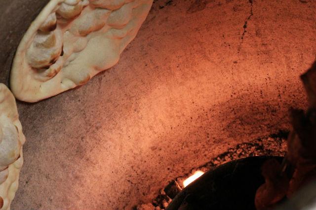 Tandoot-A peak inside the Tandoor-clay oven