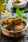 Chicken biryani dum method served in a copper handi