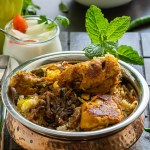 Chicken biryani dum method served in a copper handi