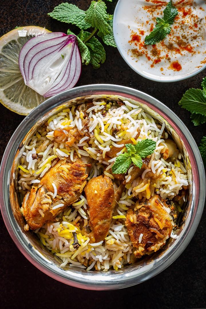 Best Chicken dum biryani served with raita