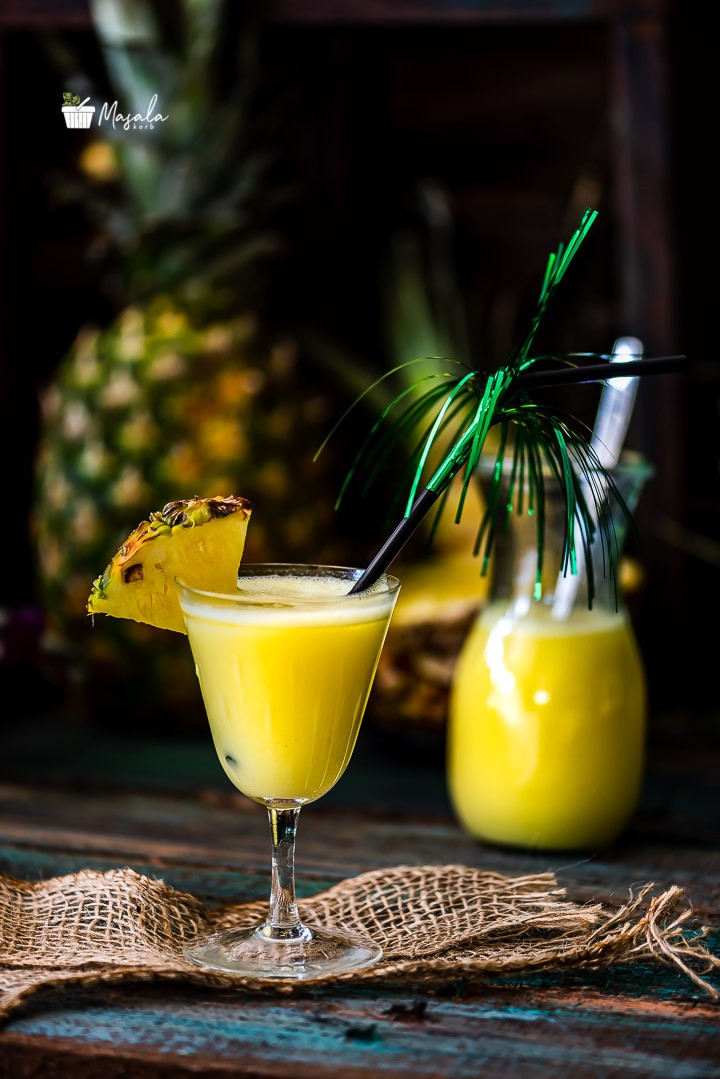 Pina colada served in a glass and a jar.