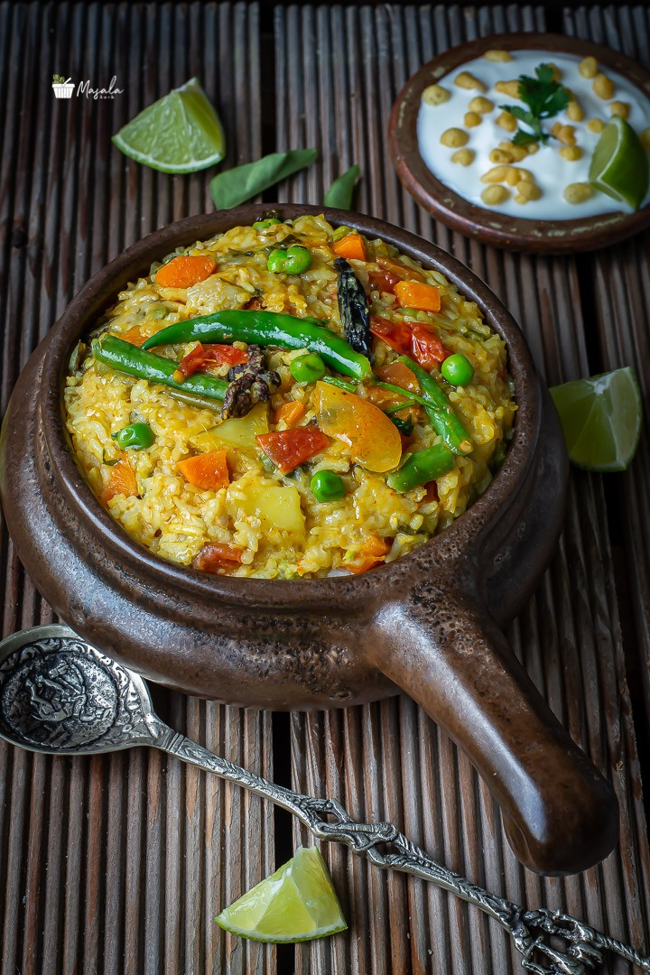 Vegetable khichdi served in a brown bowl