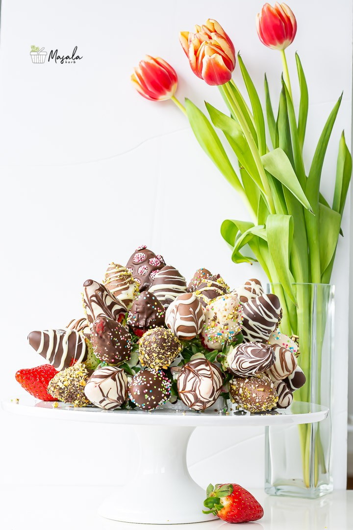 Chcolate covered strawberries bouquet with tulips bouquet