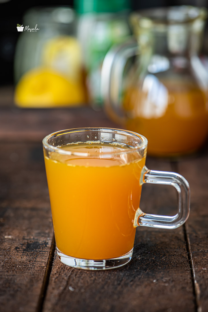 Turmeric tea served in a glass cup.