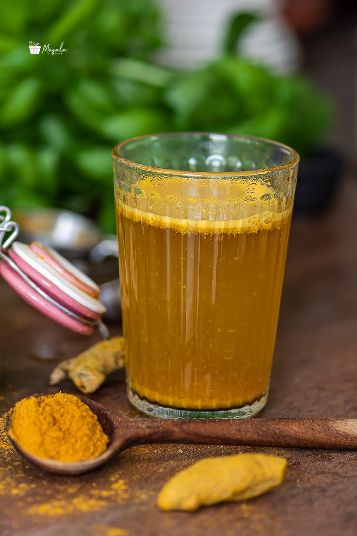 Haldi tea for weight loss served in a glass.