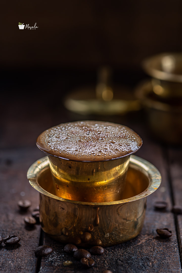 Indian filter coffee seved in a brass dabarah and tumbler