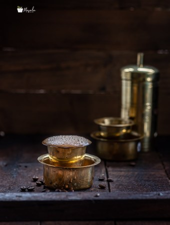 South Indian filter coffee seved in a brass dabarah and tumbler