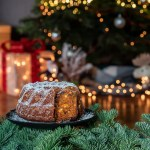 Christmas plum cake with Christmas tree decoration.