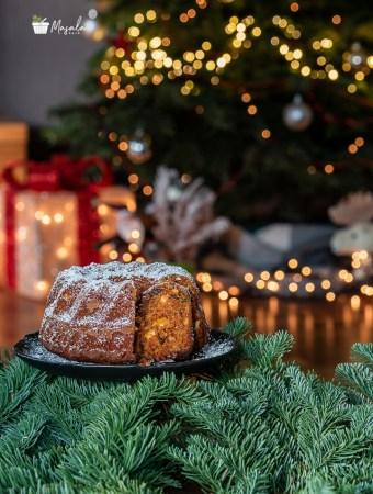Christmas plum cake with Christmas tree decoration.