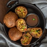 Potato Bread Rolls Recipe Indian - Bread Bonda Recipe served on a black plate