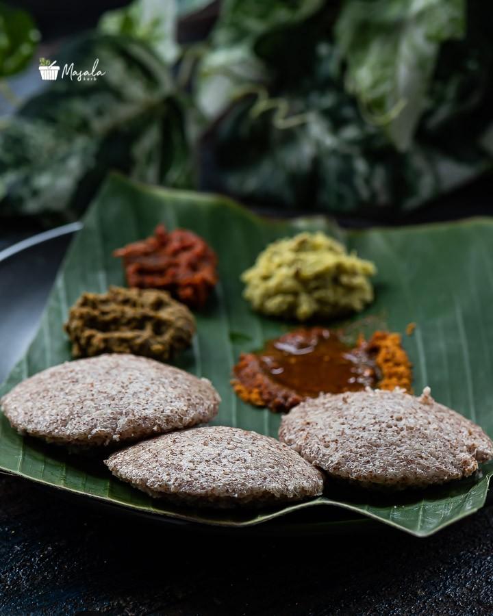 Nachni idli served on a banana leaf