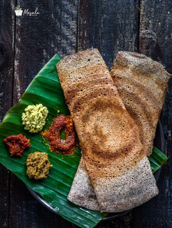 Crispy Ragi Dosa Recipe | Finger Millet Dosa served with an assortment of chutneys and gun powder.