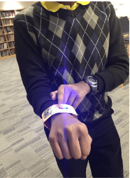 A student shows off their wearable tech creation - a bracelet that lights up.