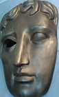 By EG Focus (The famous Bafta awards mask at Piccadilly, London) [CC BY 2.0 (http://creativecommons.org/licenses/by/2.0)], via Wikimedia Commons