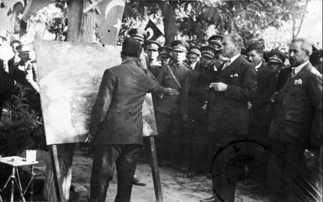Mustafa Kemal, inspecting the new literacy skills of functionaries in Sivas, September 1928.