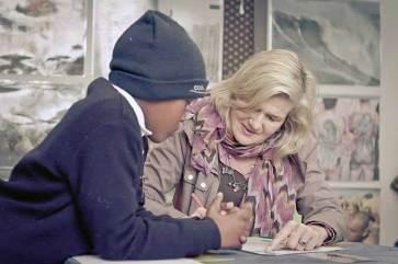 Masicorp volunteers help children in the library's popular 'Homework Club'