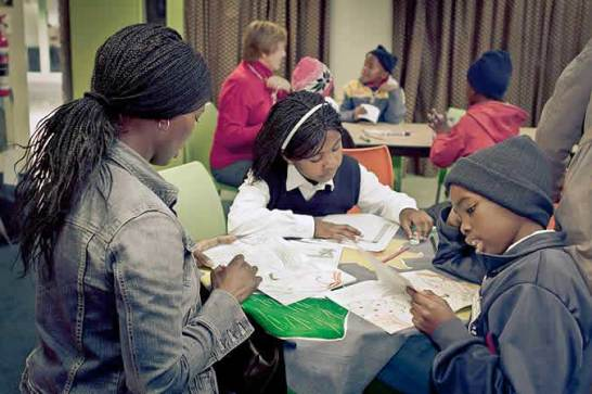 Volunteers help with homework and also do exercises and games to improve reading, maths and writing skills
