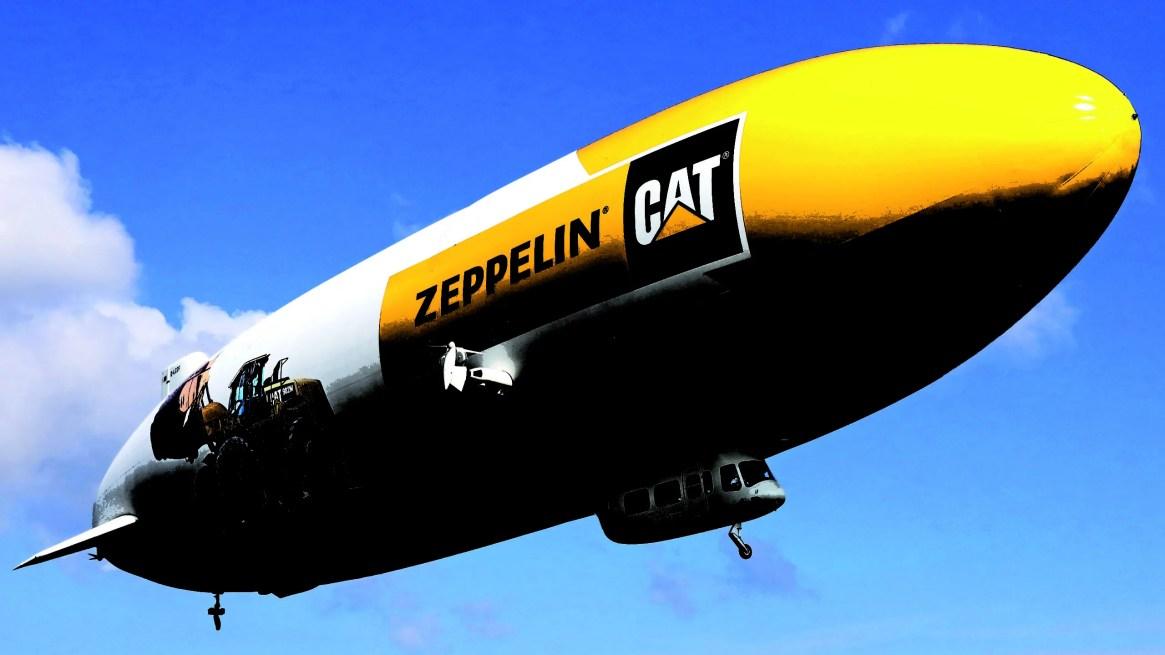 Den klassiska zeppelinaren med en Cat 982M-hjullastare och logotyp. Zeppelin GmbH ägs av stiftelsen Zeppelin-Stiftung samt Luftschiffbau Zeppelin GmbH. Stiftelsen grundades av Ferdinand von Zeppelin 1908.