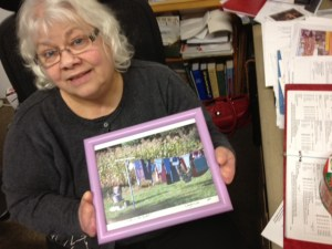 Linda Holden holds a photograph Douglas Hill created for her.