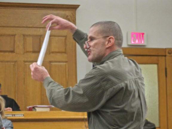 McCallum shows a document to the court.