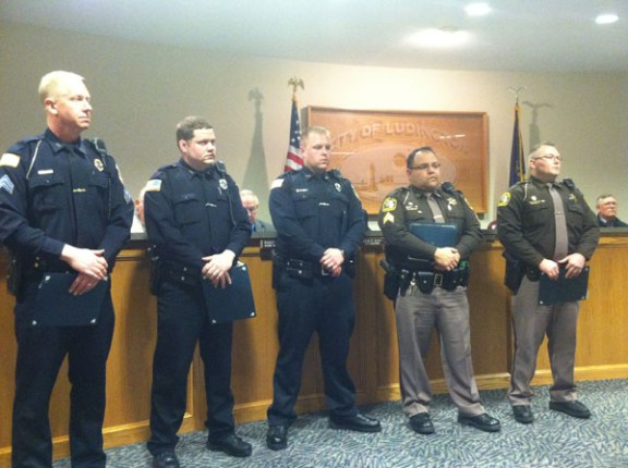 Officers receiving bravery citations were (from left to right) Sgt. Dave Maltbie, Officer Aaron Sailor, Officer Jason Smith, Sgt. Oscar Davila, and Deputy Derrek Wilson.