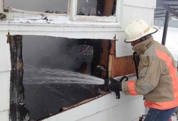 Chief Burke sprays water in a window