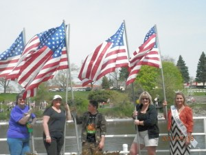 Spectators hold American flags. Photo by Miranda Beebe.