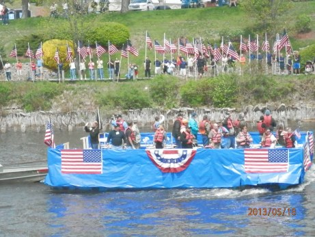 Veterans ride through the Manistee channel. Photo by Miranda Beebe.