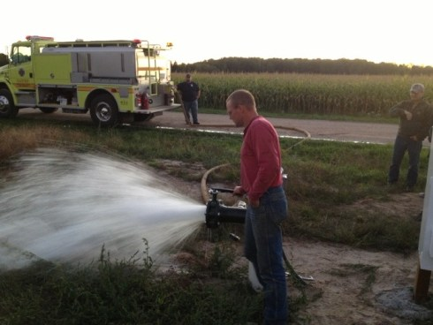 Zake Zwagerman demonstrates how the irrigation well will work with fire departments.