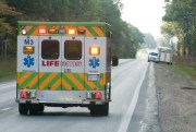 Life EMS ambulance transports the woman to an awaiting helicopter.