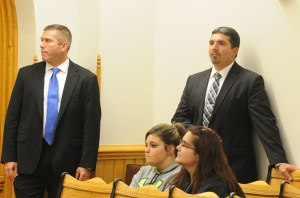Ariel Courtland, seated left, was in the courtroom along with detectives Wells, standing left, and Kinney
