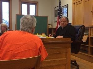 Lyle testifies to Judge Cooper.