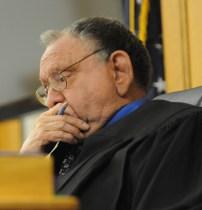 Judge Richard Cooper listens to testimony.