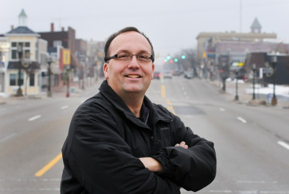 Mayor Henderson stands at the west end of downtown Ludington.