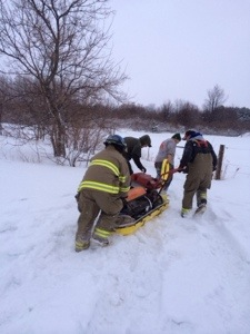 Firefighters use a sled to bring up heating supplies for the horse.