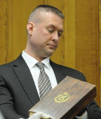 MSP Lt. Jeff Crump holds the .357 Colt handgun box that was found in the pickup truck driven by Eric Knysz.