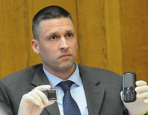 Linke shows a cell phone found in the Pontiac.