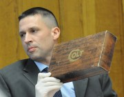 Sinke shows a Colt revolver box. The box contained the serial number matching the murder weapon.