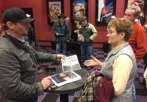 Cronk talks with Donna Clousing and other audience members after the film.