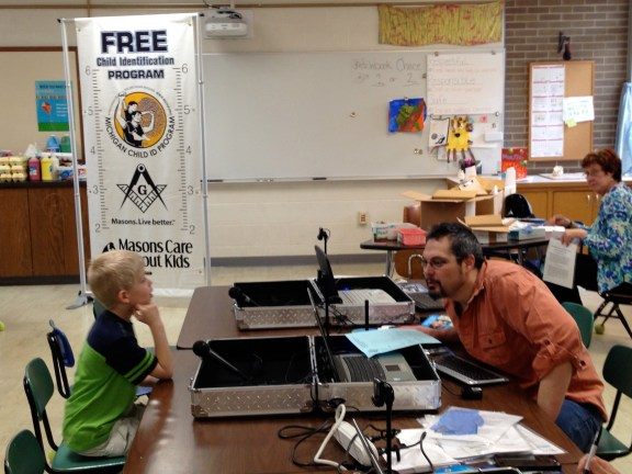 Lakeview student, Alex Bunker answers questions asked by Mason member Mark Rogers Thursday morning. The Masons visited Lakeview Elementary School to complete the Michigan Child ID Program. The program helps  expedite law enforcement in emergency situations.