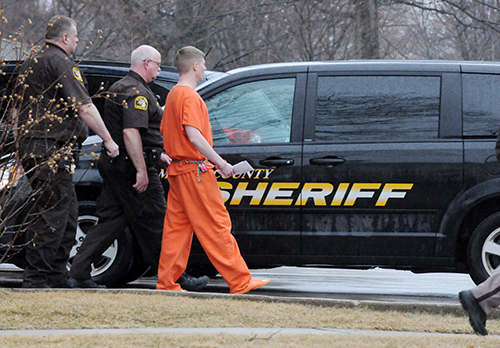 Sean Phillips being led away by Mason County Sheriff's corrections officers.