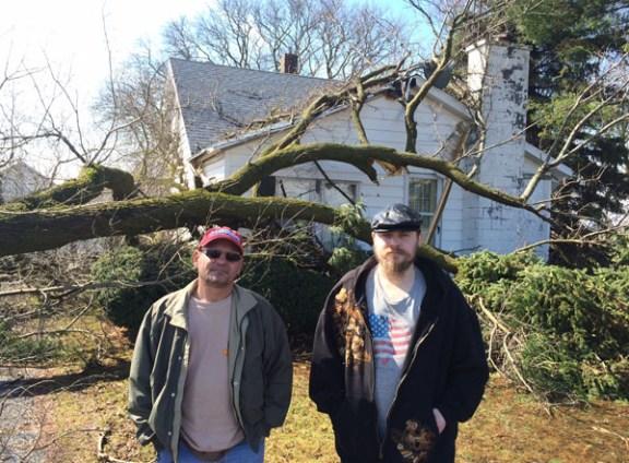 Bert, left, and Logan VandenHuevel outside their house on Washington Road.