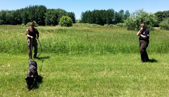 Dep. Baum trains with K-9 Cash as Sgt. Mendham looks on.