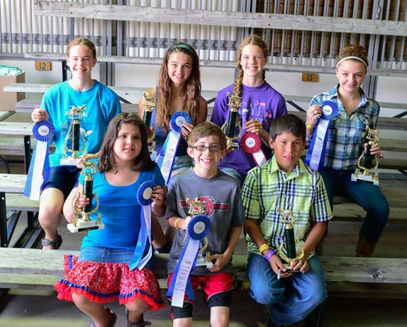 Goat showmanship winners. In front, from left: Mallory Oomen, 1st place 7-8 year-old ; Jackson Doyle, beginner 1st; Keegan Bates, beginner 2nd. Back row, from left: Miriam Wilson, 1st intermediate; Catie Lane, 1st jr.; JoyEllen Wilson, 2nd jr.; Abbie Berringer, 1st sr.. Not pictured: Christian Cheaney, 1st 5-6; Frances Cheney, 2nd 7-8; Cammie Shoup, 2nd intermediate.