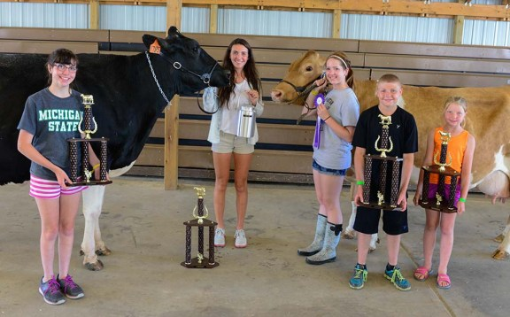 Dairy winners. In front, from left: Leah Larsen, reserve champion holstein; Ryan Crawford, grand champion jersey; Brianna Campbell, reserve champion jersey, grand champion ayrshire. In back, from left: Lindsay Larsen, grand champion holstein; Brooke Thurow, grand champion gurney, reserve gallon; dairy showperson of the day.