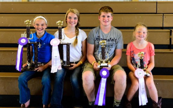 Swine winners. From left: Olivia Flewelling, overall grand champion market hog; Claire Flewelling, overall reserve champion market hog; Austin Larr, grand champion homegrown; Briana Crawford, reserve champion homegrown.