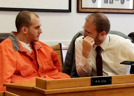 Jon Maccune, left, speaks with his attorney, David Glancy.