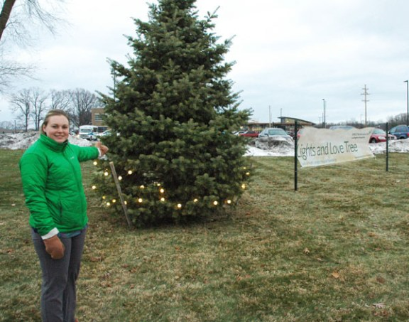 Rosie Jensen, foundation development coordinator stands next to the tree. Photo by Bill Kerans, SHLH.